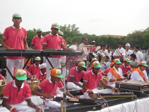 Children performing at Karan Stadium on the occasion of Independence Day